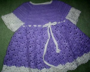 Purple dress with white accents for baby girl