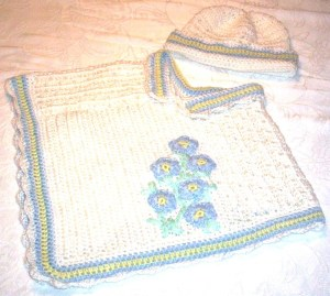 Forget-me-not poncho and matching bonnet