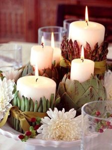 candles in artichokes centrepiece