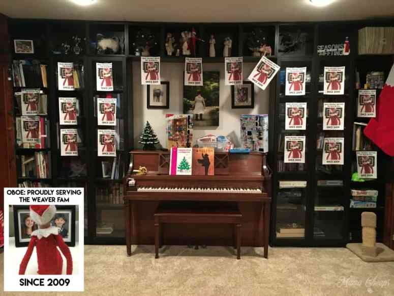 Elf Hangs up Pictures All Over