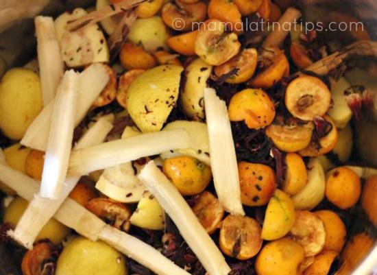 sugarcane sticks, tejocotes, guavas and apples cut in halves