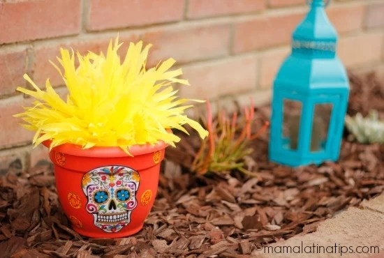 orange flower pot with a sugar skull drawing