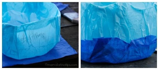 Adding layers of blue tissue to a milk jug - mamalatinatips.com
