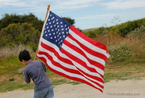 Kid with American Flag - mamalatinatips.com
