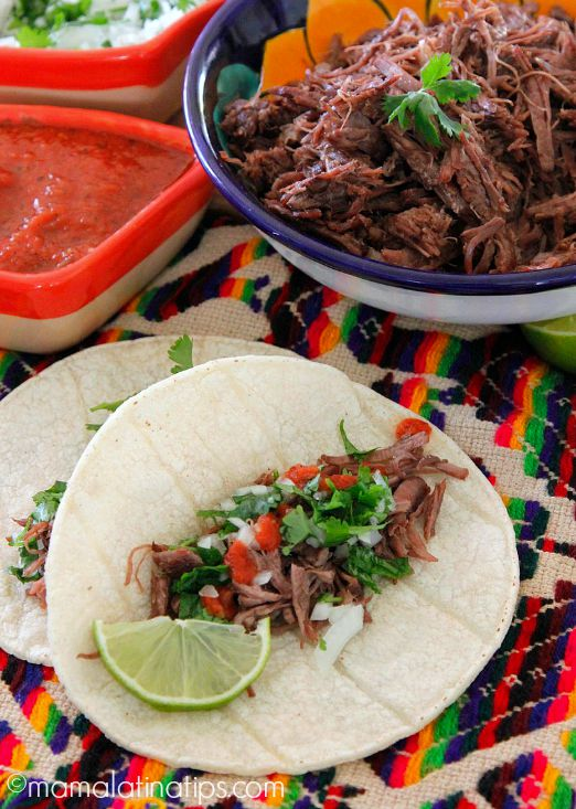 Beef barbacoa taco with lime