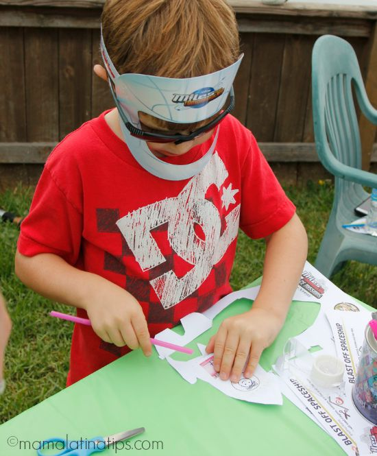 Kid making a paper rocket