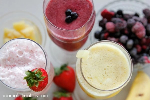 Smoothie bar with a berry smoothie, strawberry smoothie and pineapple smoothie