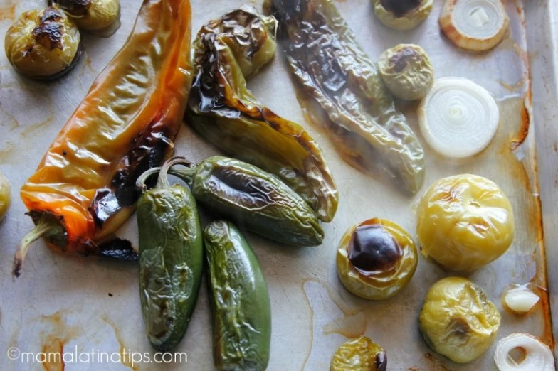 Roasted jalapeño and Ahaheim peppers, tomatillos and onion