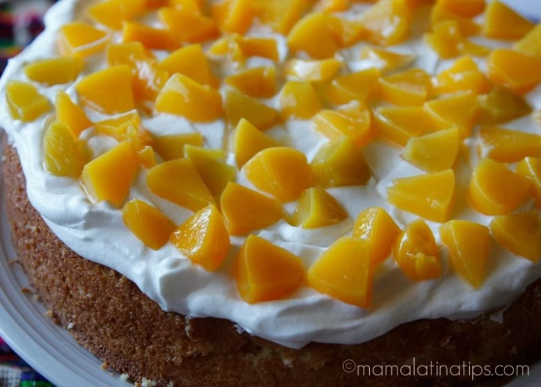 tres leches cake with peaches and whipped cream