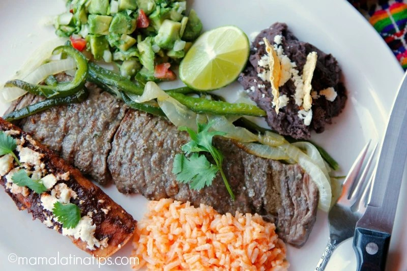 carne asada tampiqueña with guacamole, red enchilada, rice and beans