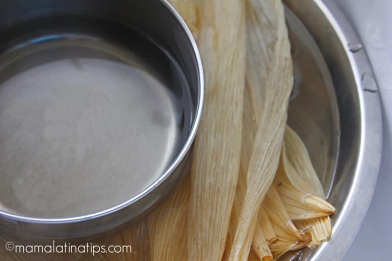 Dry corn husks submerged in water