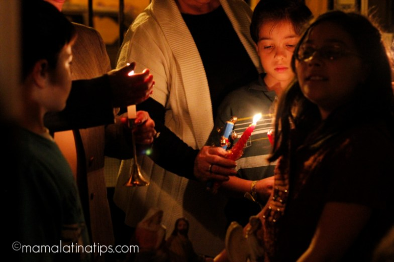 kids lighting a candle
