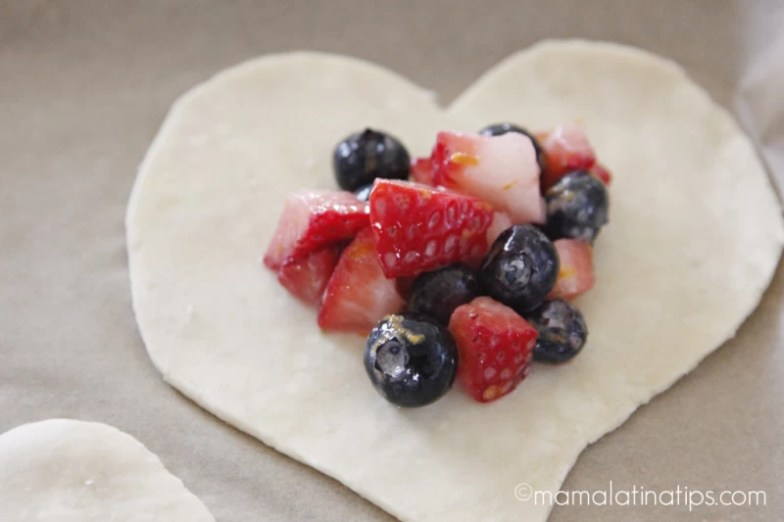 Chopped berries on top of a heart shaped dough