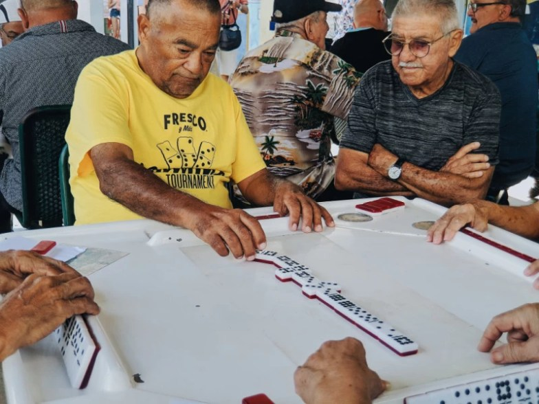 Senior citizens playing dominoes