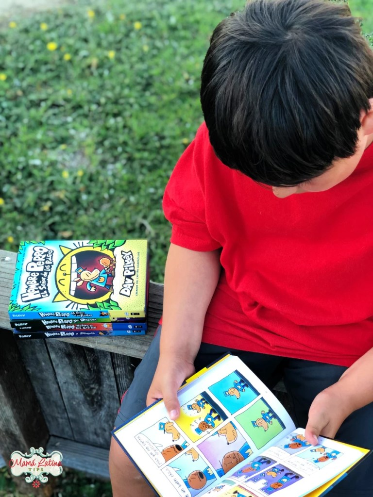 kid reading a book by Dav Pilkey and Hombre Perro book