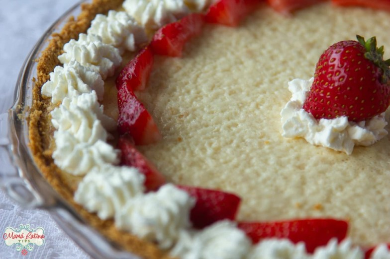 cheesecake with whipped cream and strawberries