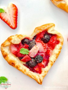 Heart shaped rustic tarts with berries, strawberries and mint