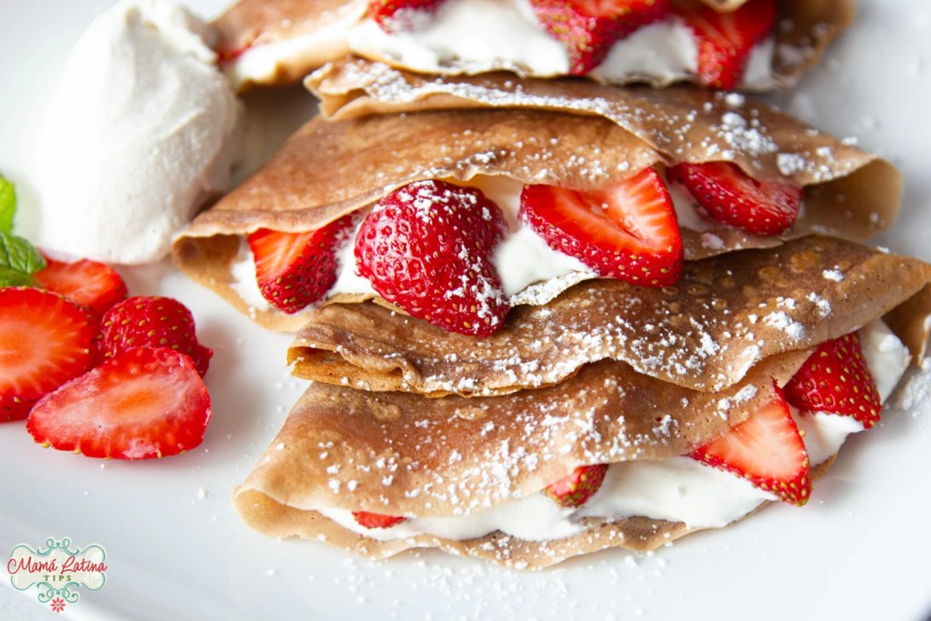 Three chocolate crepes with strawberries and ice cream