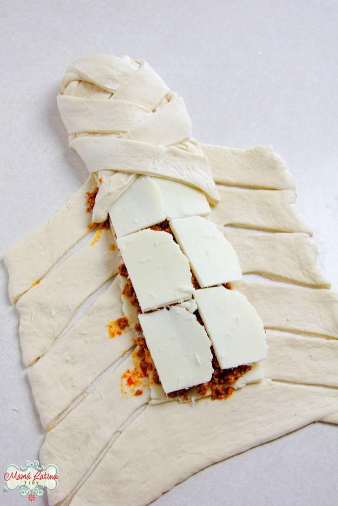 braiding dough stuffed with chorizo and cheese