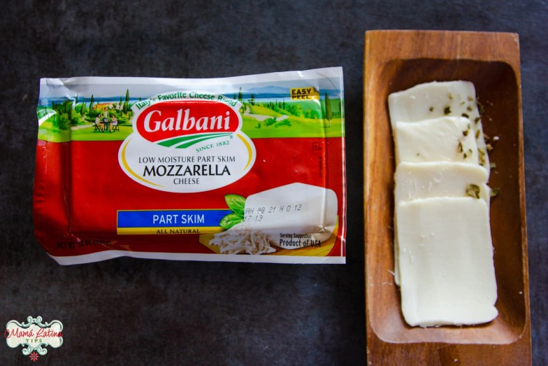 Galbani low moisture mozzarella cheese package along with sliced mozzarella in a wooden plate