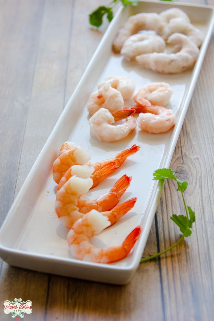 three types of shrimp on top of a rectangular plate