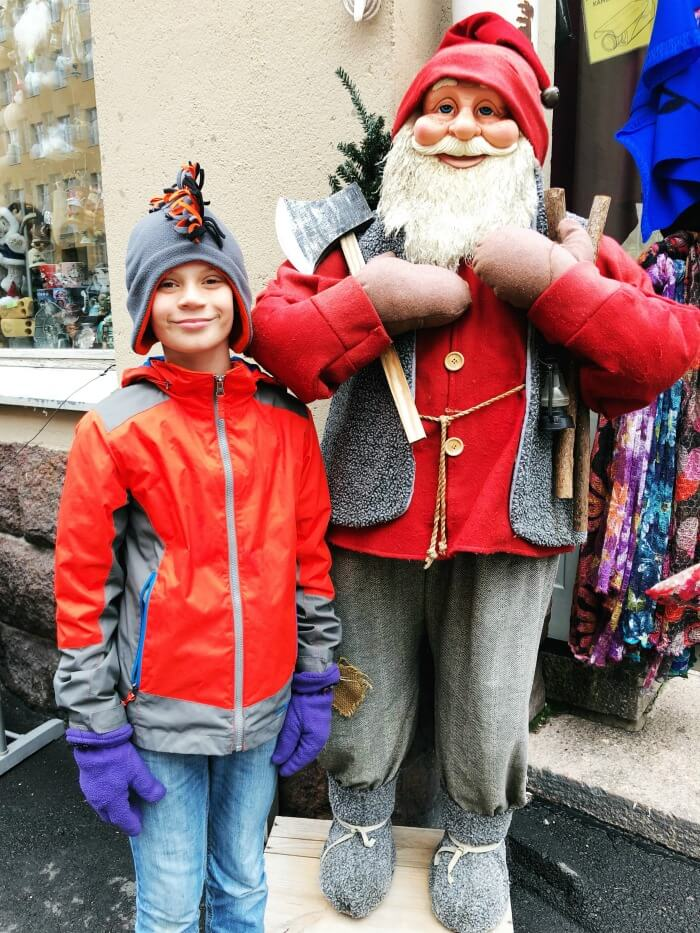 POSING WITH A GNOME HELSINKI FINLAND