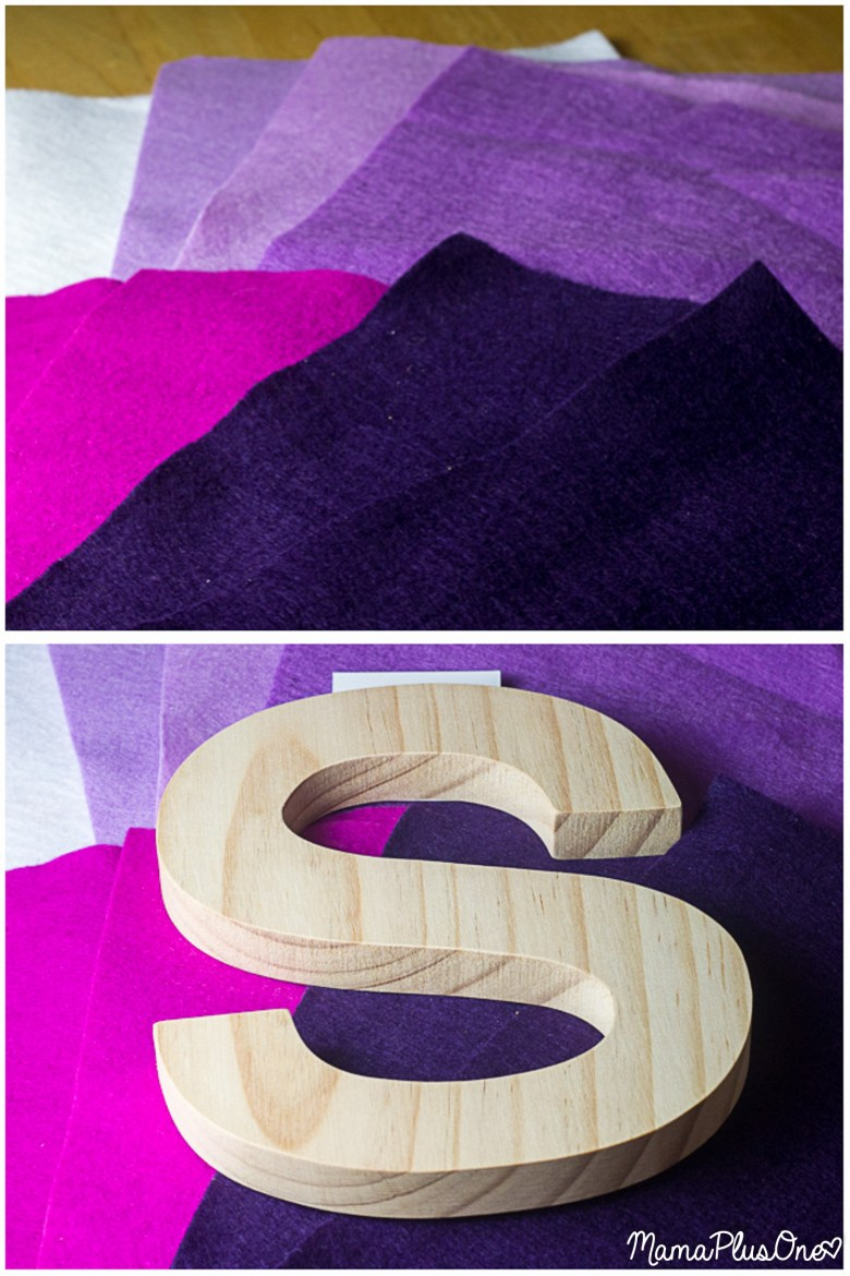 If you're looking for the perfect door hanging or office decor, you're going to love this impossibly easy ombre flower monogram! If you can trace a circle, fold a piece of felt, and use a hot glue gun, you can make this! It is the perfect substitute for a DIY Wreath, or looks great on any wall! Just pick the letter or wooden shape that appeals to you, and you're all set to make this fun creation!