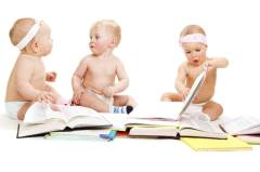 Babies group reading books
