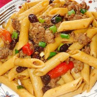 PENNE PASTA WITH SWEET SAUSAGE, ROASTED PEPPERS & RAISINS