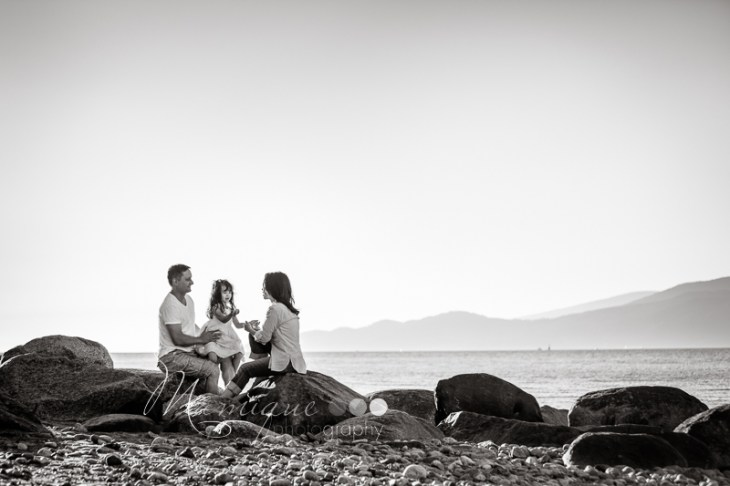 Family on a rocky beach in Vancouver Spanish Banks
