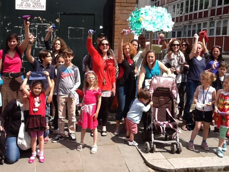 Parents and children protest outside the school gates on July 7
