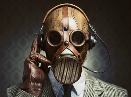 Vintage gas mask and headphones