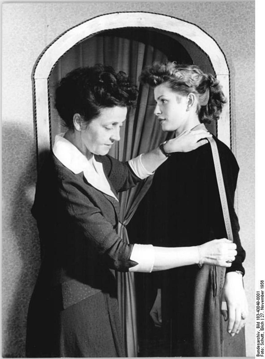 Woman being measured by a seamstress