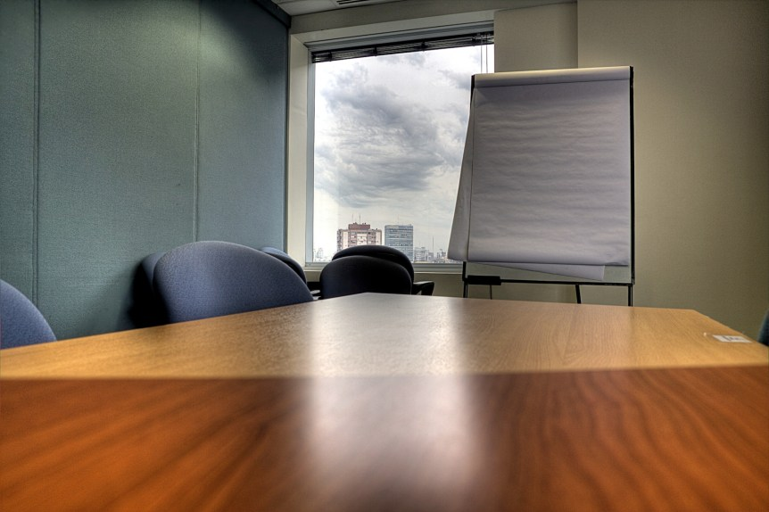 Meeting room, table and paper board. (c) 2008 Luis Argerich of Buenos Aires, Argentina. Via Wikimedia. (CC BY 2.0)