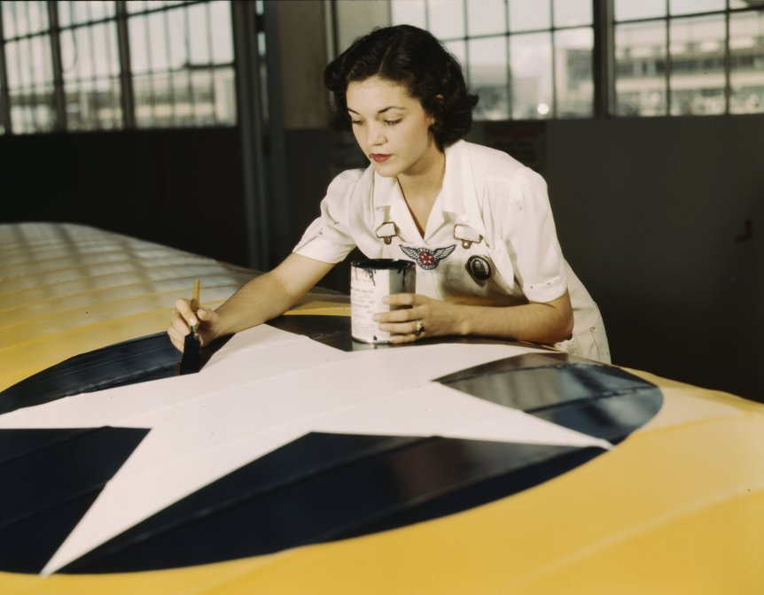 Painting the American insignia on airplane wings is a job that Mrs. Irma Lee McElroy, a former office worker, does with precision .... 1942. By Howard R. Hollem, via Library of Congress