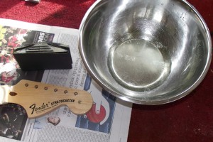 Use a sanding block, P400 paper and water with a bit of washing up liquid in it