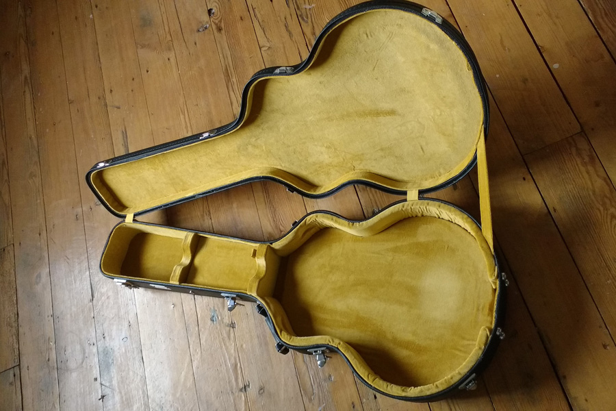 Spider guitar case relined with yellow velvet