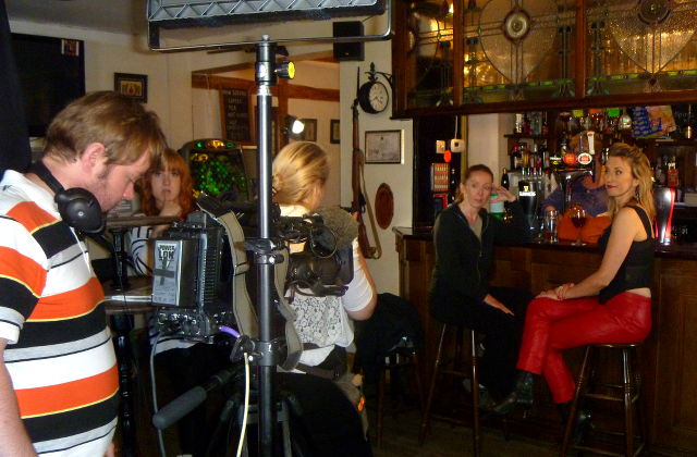 Film crew in a bar