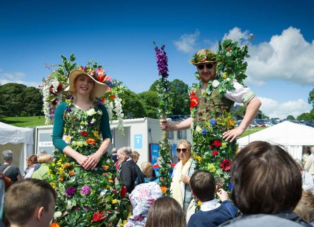 Stilt walkers at the inaugral RHS Chatsworth Flower Show 2017. Picture; RHS/Sirastudio
