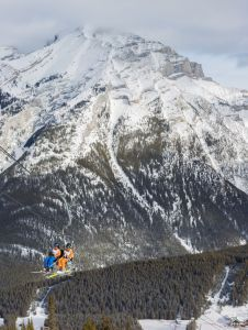 Friends ride the chairlift to the top of the mointain at Mount Norquay.