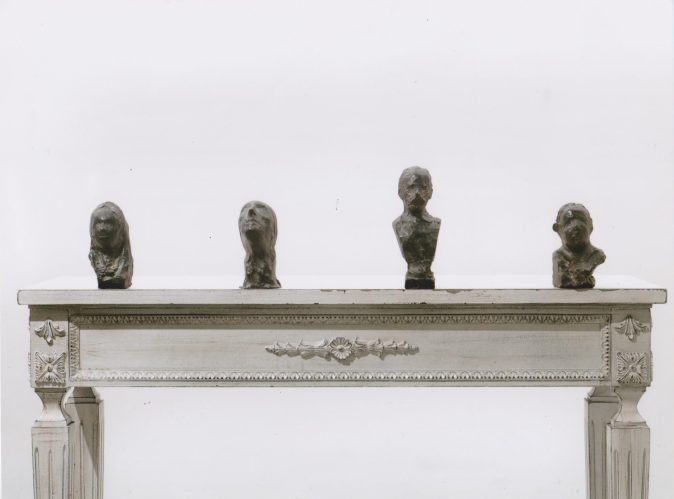 Untitled, bronze heads on wooden table, 2015, variable dimensions