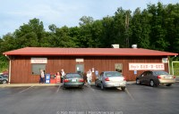 parking lot of a well-kept restaurant with tin roof where kentucky barbecue is served