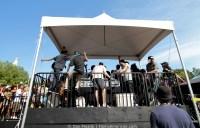 Kids behind a DJ tent.