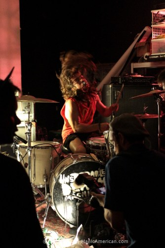 Billy Tucci playing the drums.