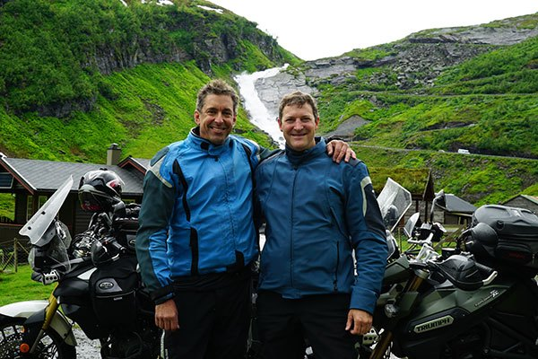Manic Nomads in Norway in front of a waterfall