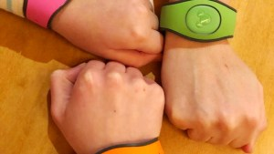 three magic bands on three wrists