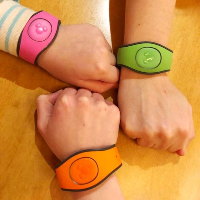 three magic bands on three wrists