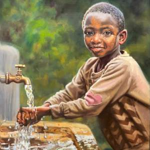 young boy washing hands