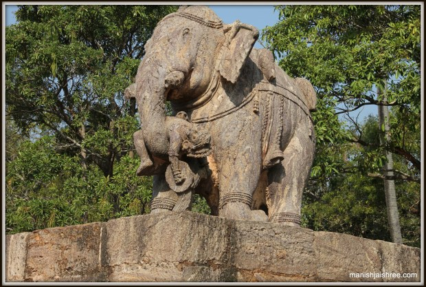 A statue of an elephant holding a men in its trunk in the complex