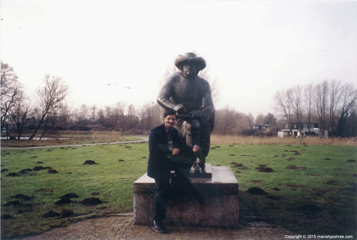 The Statue of Rembrandt near the windmill and a picturesque surroundings